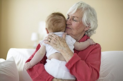 10 Mar 2008 --- Grandmother Hugging Baby --- Image by © LWA-Sharie Kennedy/Corbis